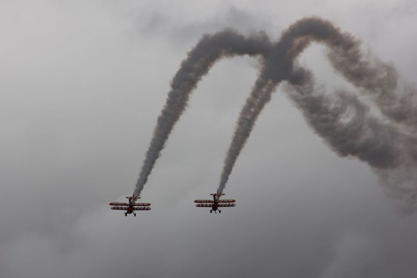 Brietling Wing-Walkers Display Team Mode Of Transport Transportation Airplane Air Vehicle Flying Travel Low Angle View Sky Mid-air Journey Airshow Teamwork Day Coordination Scenics No People Fighter Plane Smoke - Physical Structure Arts Culture And Entertainment BRIETLING TEAM