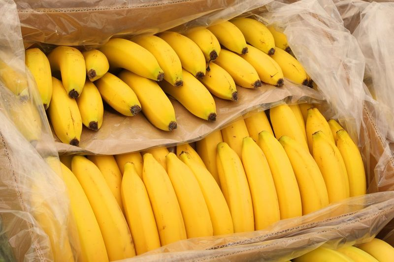 Yellow ripe bananas on the box for sale at market