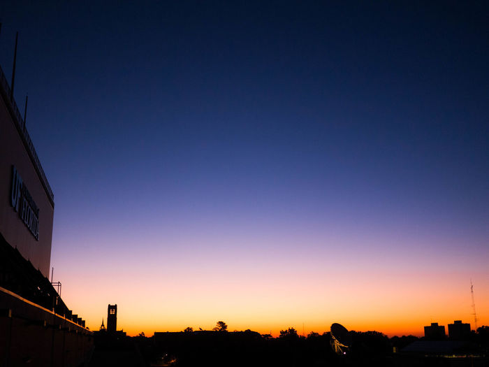 Silhouette of city at dusk
