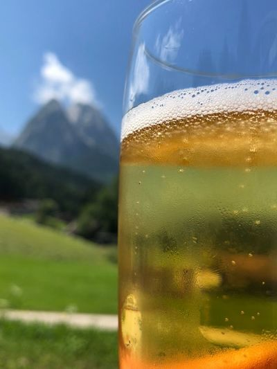 Beer in front of the Mountains Drink Refreshment Drinking Glass Food And Drink Household Equipment Glass Freshness Close-up Focus On Foreground Glass - Material No People Transparent Alcohol Water Nature Cold Temperature Frothy Drink Beer Beer - Alcohol Table