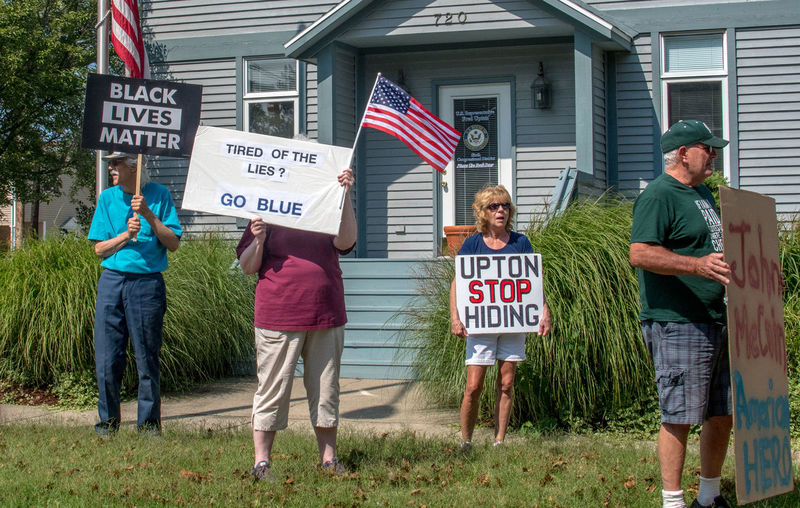 St Joseph Michigan, September 2018; real people exercise their right to free speech by holding protest signs of relevant topics of the day Adults Only FREEDOM OF SPEACH Freedom Michigan, USA North America Signs American People Beleif Day Editorial  News Outdoors People Picket Signs Protesters Protesting Right To Free Speech St Joseph Michigan Standing Text Western Script