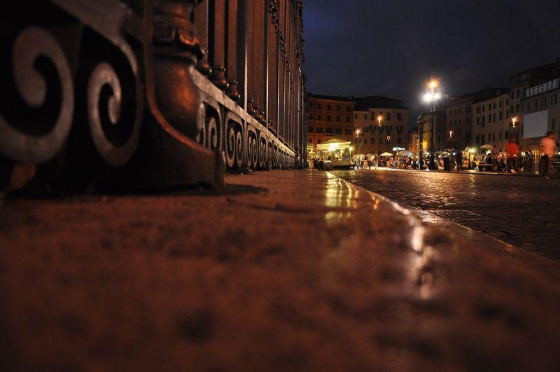 Illuminated Sidewalk At Night