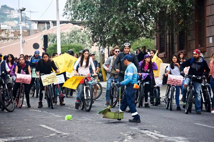 The bikers would not move until the only cleaning person would remove that last trash, trash left there by the other groups of the protest parade ahead. Cleaning LatinAmerica Worker Bicycle Protest Crowd Day Large Group Of People Outdoors Protesters Social Classes Social Contrast Work Class First Eyeem Photo