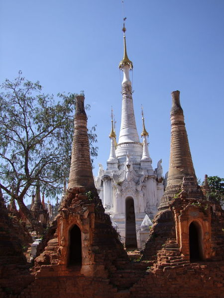 Old Stupas (11th to 13th century) & New Stupa Ancient Ruins Blue Sky Buddhism Buddhist Architecture Buddhist Culture Buddhist Stupas Composition Full Frame Inle Lake Kakku Myanmar Old And New Architecture Old And New Buildings Outdoor Photography Place Of Prayer Place Of Worship Religion Shan State Stupas Sunlight And Shade Tourism Tourist Attraction  Tourist Destination Tree
