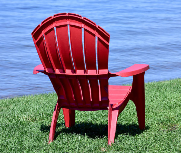 Summer red chairs in minnesota along the lake