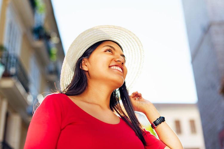 Smiling young woman wearing hat