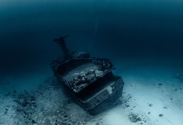 Abandoned boat in sea