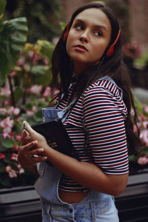 i'm yr baby, 2018 90s Retro Beautiful Woman Casual Clothing Contemplation Focus On Foreground Front View Hairstyle Holding Leisure Activity Lifestyles Looking Looking At Camera One Person Outdoors Plant Portrait Real People Standing Teenager Three Quarter Length Waist Up Women Young Adult Young Women