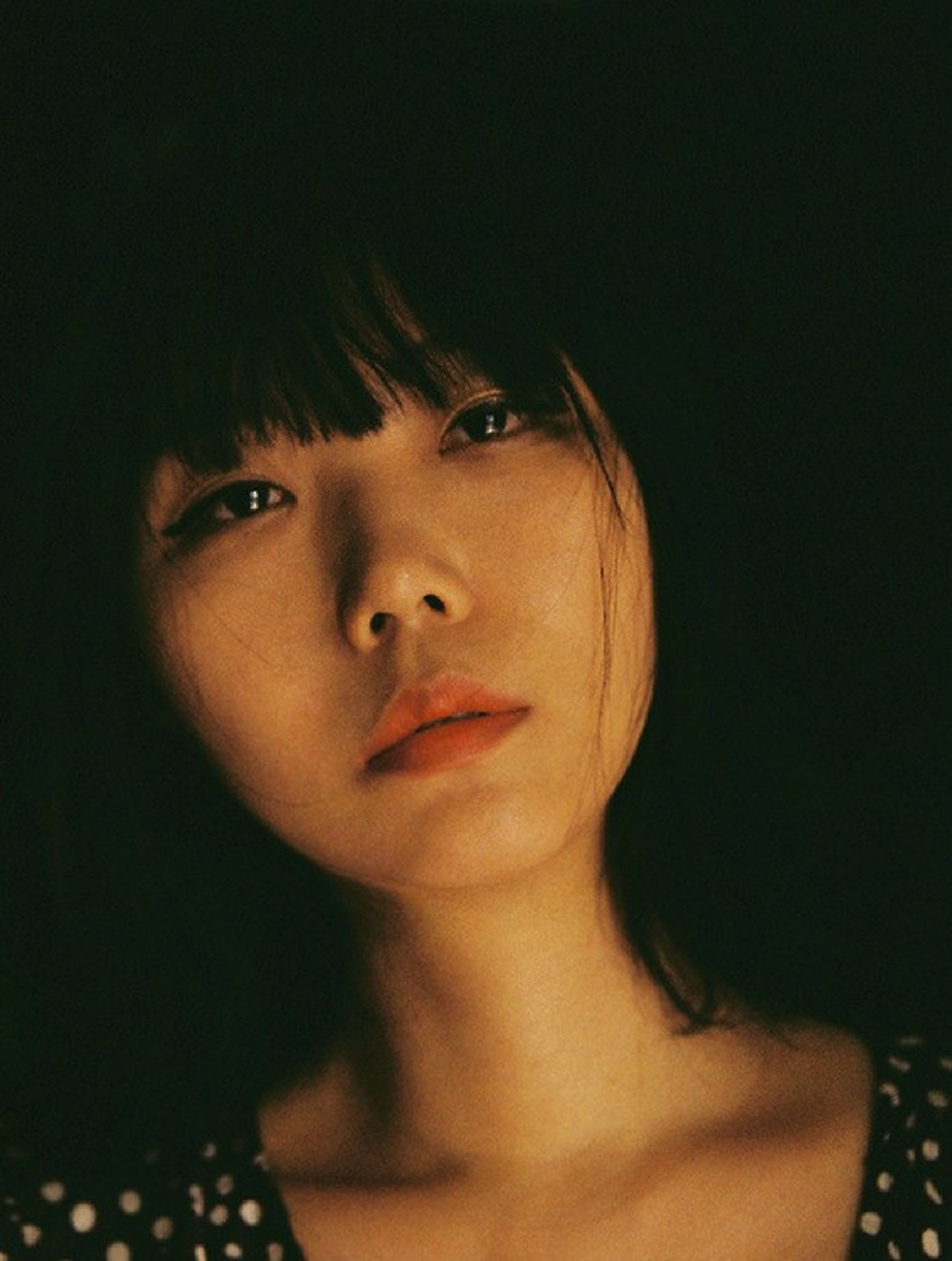 headshot, portrait, one person, front view, young women, young adult, looking at camera, indoors, women, lifestyles, real people, beautiful woman, close-up, beauty, looking, hairstyle, hair, leisure activity, contemplation, human face, black background, bangs