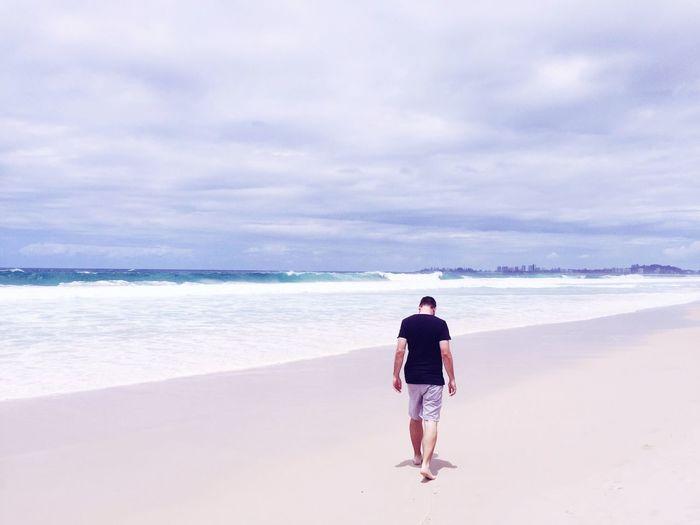 Beach walk. Adventure Male Model Getty Images Getty EyeEm Best Shots EyeEmPaid Pose EyeEm Selects Sea One Person Beach Sky Rear View Water Nature Outdoors