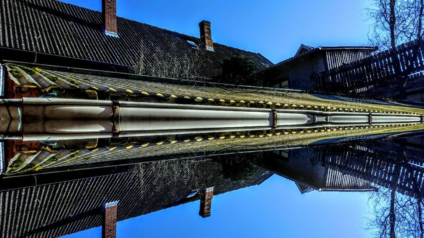 Clear Sky Reflection Water Sky Symmetry Low Angle View No People Blue Clear Sky Outdoors Architecture Nature