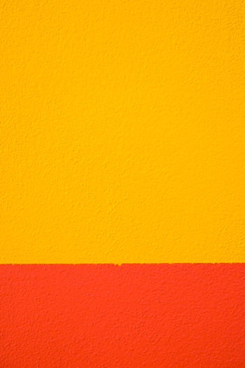 Abstract geometric pattern on concrete wall Abstract Architecture Art And Craft Backgrounds Blank Built Structure Close-up Concrete Copy Space Full Frame Indoors  Multi Colored No People Orange Color Paint Paper Pattern Red Textured  Textured Effect Wall - Building Feature Yellow