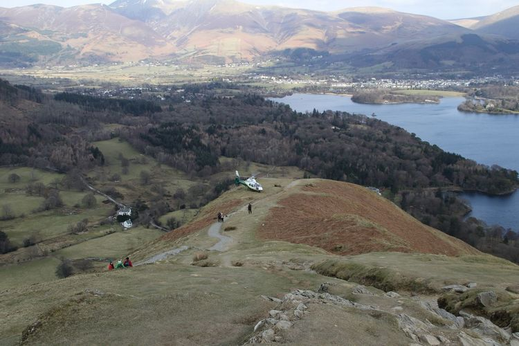 Cumbria England UK Helicopter Lake District Mountain Rescue Adventure Beauty In Nature Day High Angle View Landscape Leisure Activity Medical Helicopter Mountain Mountain Range Nature Outdoors Real People Scenics Sky Tranquil Scene Tranquility Water