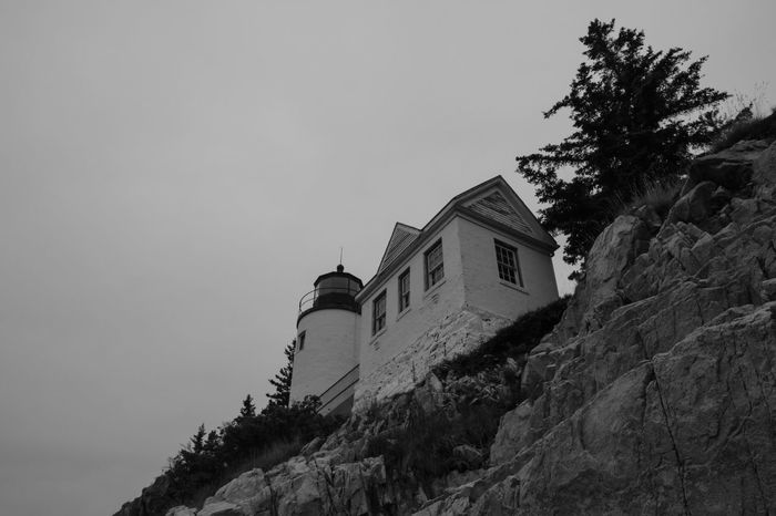 Falloff Forest Seascape Travel Light And Shadow Lighthouse Ocean Landscape Adventure Cliffs Bass Harbor Lighthouse Maine Acadia Black And White National Park Fujifilm Architecture Building Exterior Building Built Structure Sky Low Angle View Tree Plant Nature No People Copy Space Outdoors Growth