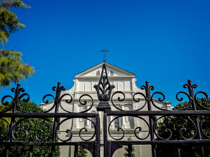 Back Side of St. Louis Cathedral with Iron Gate Architecture Blue Christian Clear Sky Cross Day Entrance Fence French Quarter Gate New Orleans, LA No People Outdoors Sky St. Louis Cathedral Tranquility Travel Destinations