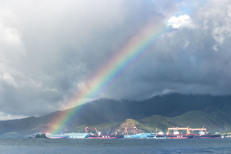 Rainbow's End Industrial Port Rainbows End Outdoors Daylight Seascape Overcast Tropical Climate Tropical Tropics DSLR Canonphotography Dslrphotography Mountain Mountain Side Pier Zoom Shot Canonphotography Port Cargo Cargo Ship Calm Sea Rainbow No People Non-urban Scene Subic Bay Zambales Countryside Boat Moored Scenics