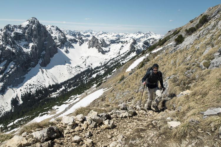 Man hiking on mountain against european alps