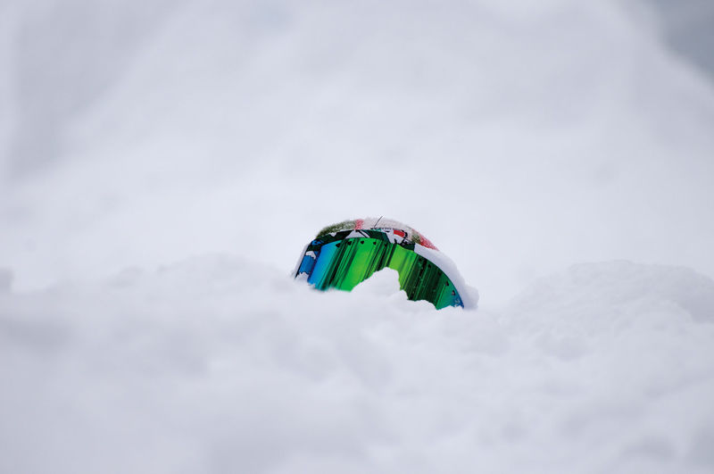 Close-up of ski goggles on snow covered field