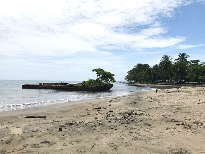 Been There. Sea Beach Sand Sky Water Tranquility Beauty In Nature Nature Scenics Tree Cloud - Sky Tranquil Scene Palm Tree No People Day Outdoors Nautical Vessel Horizon Over Water Costa Rica Puerto Viejo Beauty In Nature Done That. Caribbean