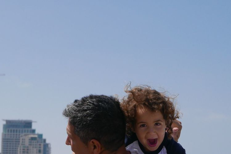 Snapshots Of Life young boy 3 y. o. on the shoulders of his father shouting Tel aviv Israel Child Holidays Father Young Boy