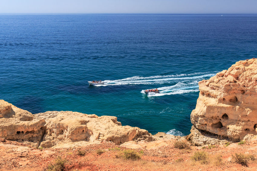 Boats heading for the cave tour on the Algarve Coast near Algar Seco Sea Water Nautical Vessel Horizon Over Water Transportation Scenics - Nature Rock Formation Rock - Object Day Cave Cave Tours Algar Seco Carvoeiro Boat Trip Algarve Algarve, Portugal Motion Wake - Water Nature Rock