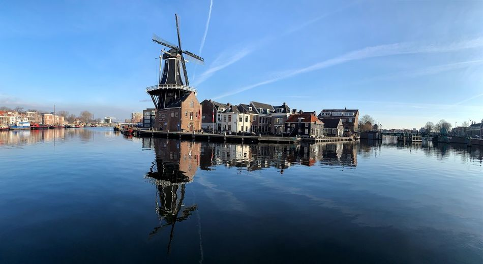 Water Architecture Built Structure Reflection Building Exterior Sky Waterfront Wind Turbine Turbine Renewable Energy Alternative Energy Nature Wind Power Fuel And Power Generation Environmental Conservation Building No People Lake Day Outdoors
