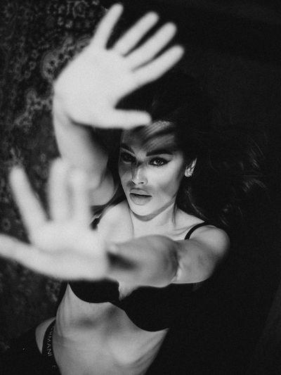 Portrait of woman in bra gesturing outdoors