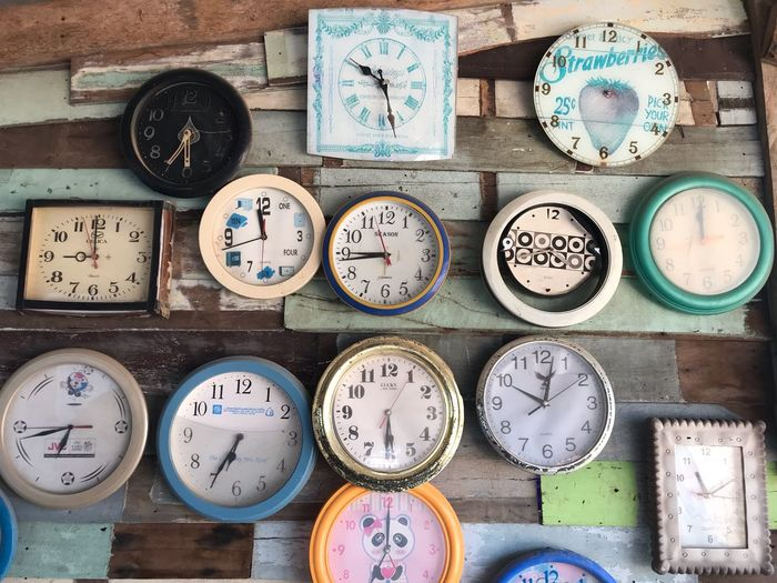 Geometric Shape Circle Indoors  Choice Time Variation Shape Western Script Communication Clock Wall - Building Feature Directly Above Large Group Of Objects No People Text Side By Side Still Life Number Arrangement Table