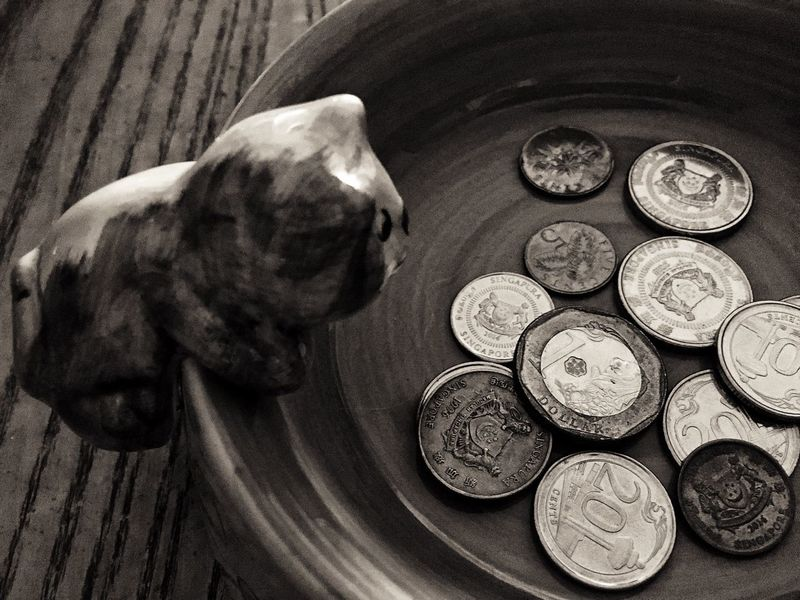 Loose change in a kitty bowl .. Loose Change Coins Cents  Penny Shillings And Pence Silver  Singapore Currency Money Kitty Bowl Tip Bowl Measly Tips Poor  Rich Or Poor Savings Cash Wealth No People Indoors  Close-up Black & White B&W Collection The Week On EyeEm