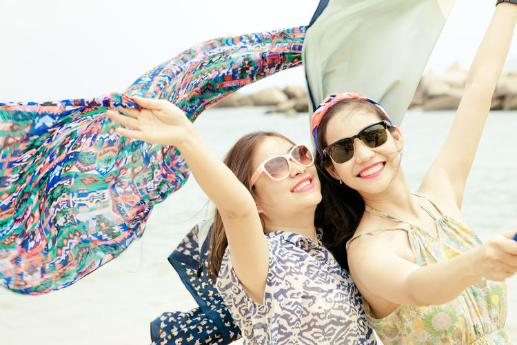 EyeEmNewHere Second Acts Day Happiness Leisure Activity Lifestyles Looking At Camera Outdoors Portrait Real People Sky Smiling Sunglasses Togetherness Two People Vacations Young Adult Young Women Fashion Stories International Women's Day 2019