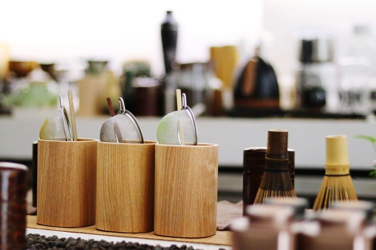 Close-up of wine bottles on table