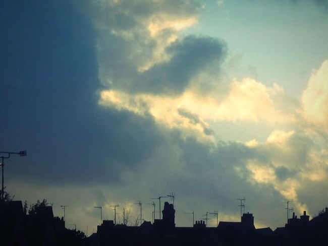 Above the Rooftops Sky Cloud - Sky Silhouette Thunderstorm Factory Nature Outdoors Day Minimalist Simplicity All In A Row Rows Of Houses Rooftops Aerials Chimney Tops industry