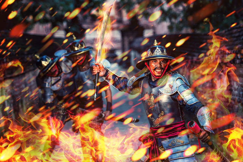 Digital composite image of fire and fighting warrior