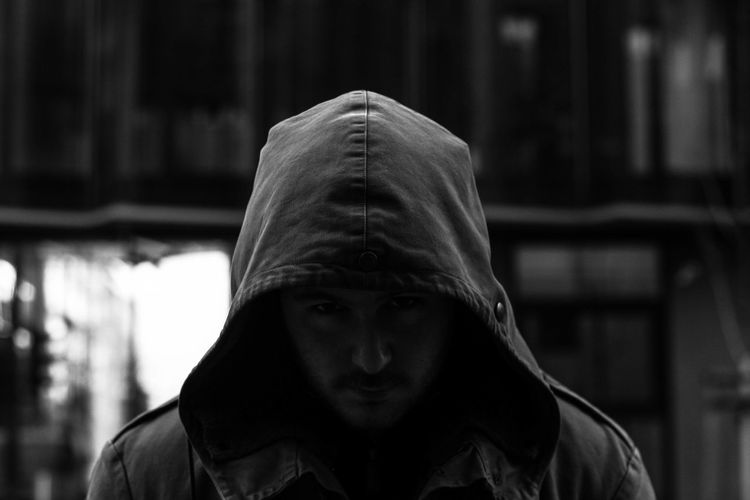 Portrait of man in hooded shirt
