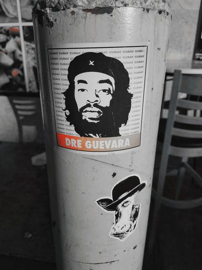 RIP Mac Dre we gon do it for the Bay!!!! Red Splash Black & White Daytime Photography Bllack And White Photography Streetphotography Urban Art Oakland, Ca. Mac Dre Communication Text