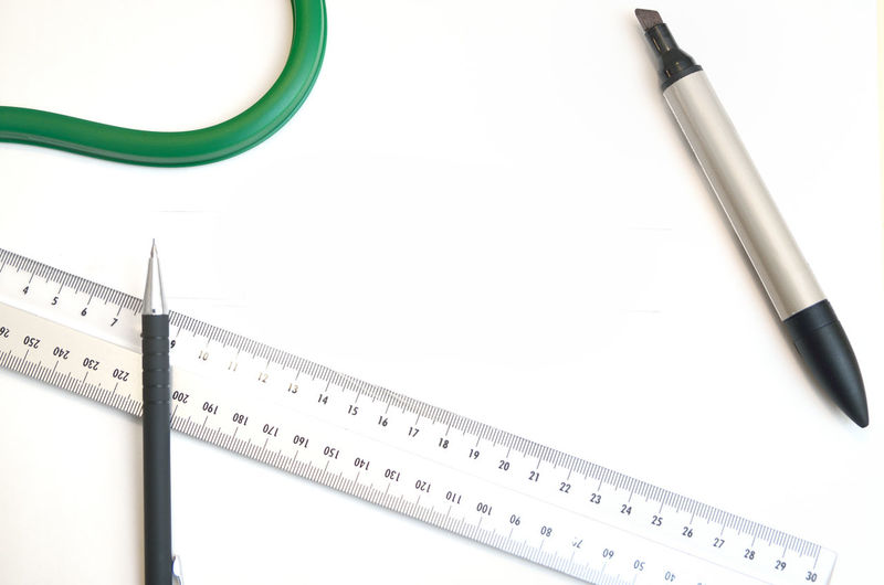 Accuracy Close-up Copy Space Cut Out Design Tools Designing Drawing Equipment Equipment High Angle View Indoors  Instrument Of Measurement Measuring No People Number Pen Ruler Still Life Studio Shot Table White Background White Color Work Tool