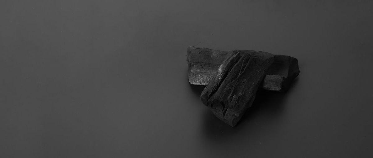 High angle view of old metal against white background