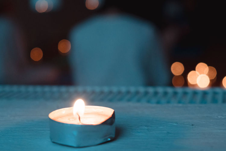Candle light on a meditation class Illuminated Flame Fire - Natural Phenomenon Focus On Foreground Lighting Equipment Selective Focus Close-up Luminosity Teal Orange Color Tealandorange Candle Candlelight Maditation Meditation Peace And Quiet