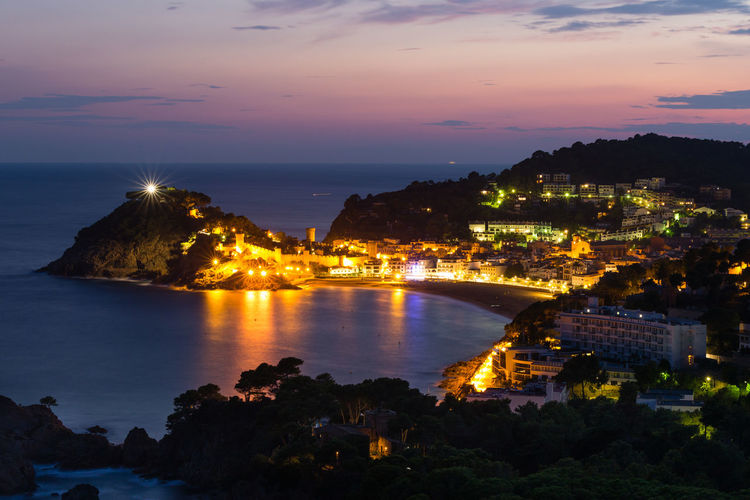 Illuminated City of Tossa de mar, Spain, and reflections of the ocean in blue hour after sunset Water Illuminated Architecture Sky Reflection Nature Night No People Sunset Outdoors Dusk Building City SPAIN Tossa De Mar Tossa Catalunya Blue Hour Reflection City Cityscape Long Exposure Castle History Travel