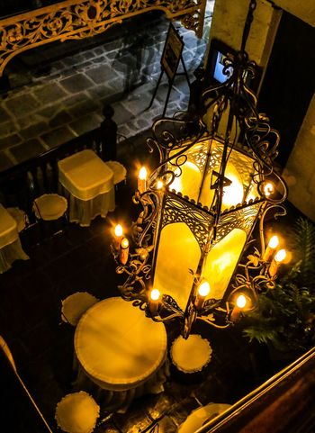 An empty unidentifiable restaurant in the Intramuros area in Manila, Philippines. Downward View Shadows & Lights Tables And Chairs Close-up Furniture Gold Colored Hanging Hanging Lamp Illuminated Indoors  Low Angle View Night No People Paint The Town Yellow