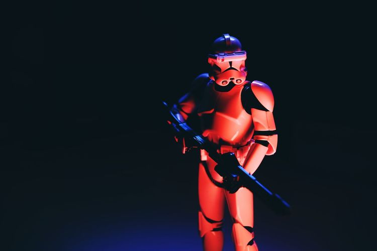 Close-up of toy figurine against black background