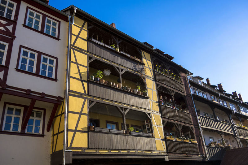 Apartment Architecture Balcony Blue Bridge Building Building Exterior Built Structure City City Life Day Erfurt Exterior Façade Famous Historical Building Krämerbrücke Low Angle View No People Outdoors Repetition Residential Building Residential Structure Sky Timbered