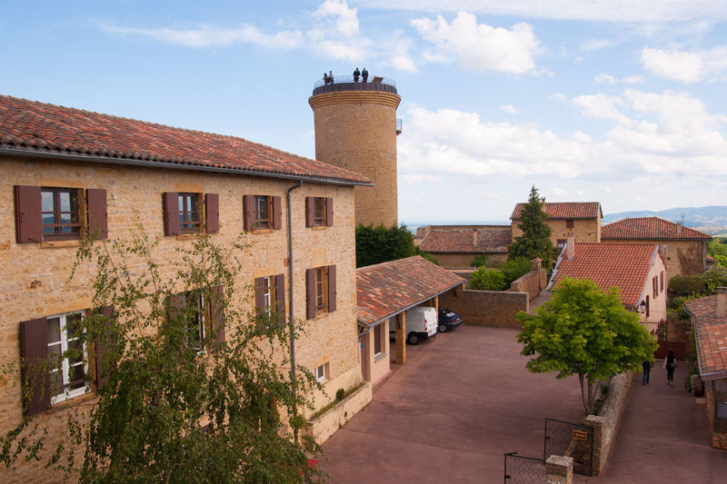 beaujolais,rhone,france Architecture Building Building Exterior Built Structure City Cloud Cloud - Sky Day Exterior Façade Growth No People Outdoors Plant Residential Building Residential District Residential Structure Sky Sunny Town