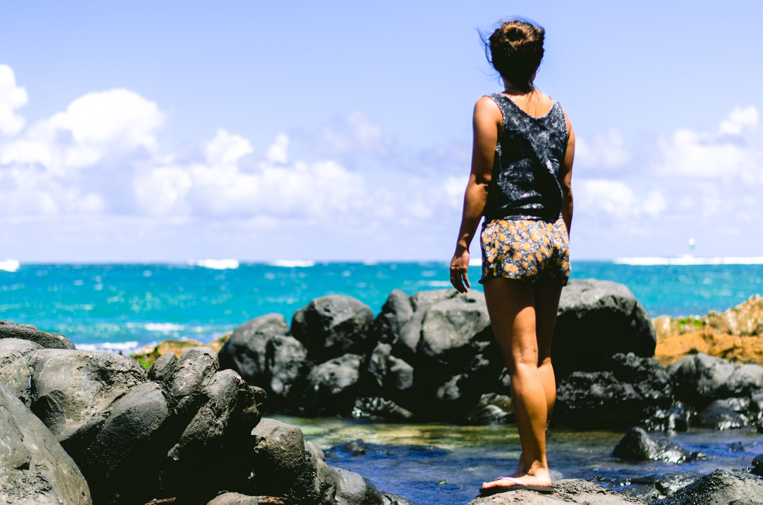 sea, water, sky, standing, horizon over water, lifestyles, full length, leisure activity, casual clothing, rock - object, beach, shore, rear view, scenics, beauty in nature, tranquility, tranquil scene, nature