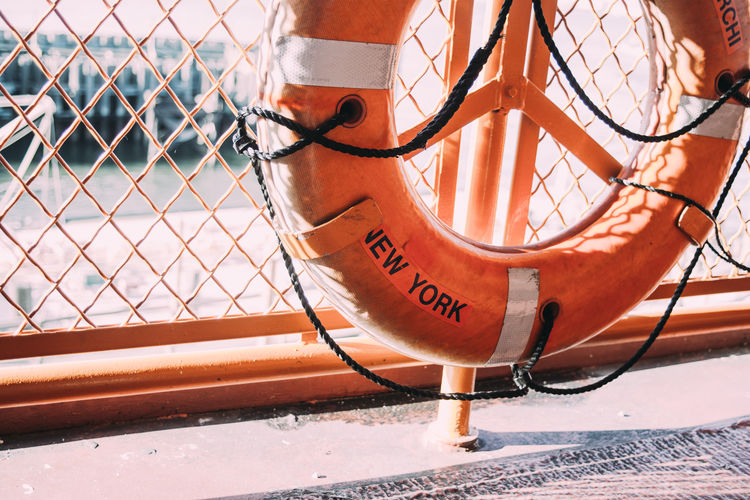 Life Belt Orange Color Fence Barrier Ferry New York Sunlight Close-up
