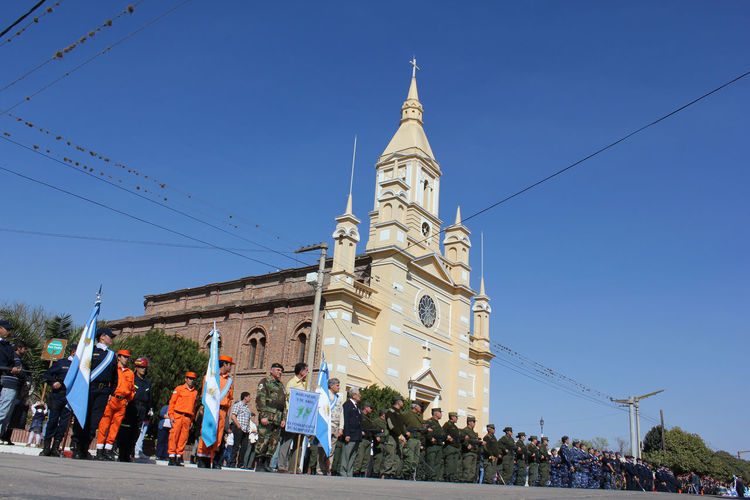 Desfile Adult Adults Only Architecture Argentina Banderas Bomberos Building Exterior Built Structure Cielo City Clock Clock Tower Cultures Day Days  Desfile Iglesia Large Group Of People Outdoors People Place Of Worship Policias Real People Sky Travel Destinations