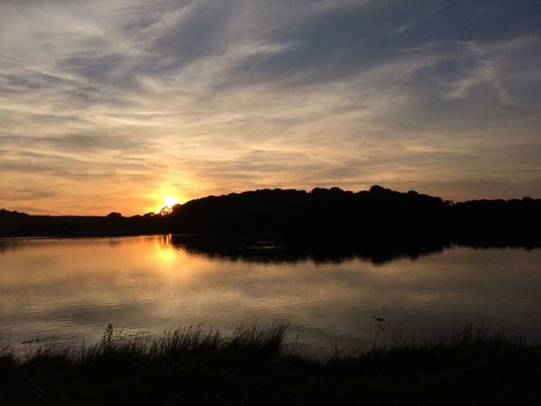 Sunset at Talkin' Tarn EyeEmNewHere Water Sunset Silhouette Nature Beauty In Nature Reflection Sky Lake Outdoors