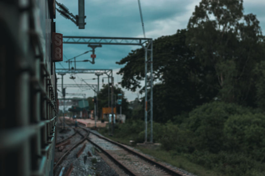 The train travel .. Nature Clouds Mothernature Travel Train Karnataka Perspective Tree Railroad Track Cable Rail Transportation Sky Architecture Built Structure Building Exterior Railway Signal Railroad Crossing Crossing Sign Electricity Pylon Railway Railway Track Signal Platform Electricity  Electric Pole Electricity Tower Power Supply Railroad Power Cable Power Line  The Traveler - 2018 EyeEm Awards