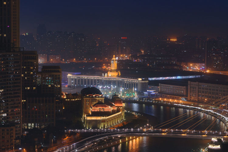 Tianjin Railway Station at night Architecture Illuminated Built Structure Night Building Exterior City Cityscape Bridge Water Bridge - Man Made Structure Connection Transportation River No People Building Nature High Angle View Travel Destinations Sky Chain Bridge Outdoors Office Building Exterior Skyscraper Tianjin China Tianjin Railways Station Clock Tower Clouds And Sky Nightphotography Railway Station Historical Building Dark Sky Illuminated Buildings China