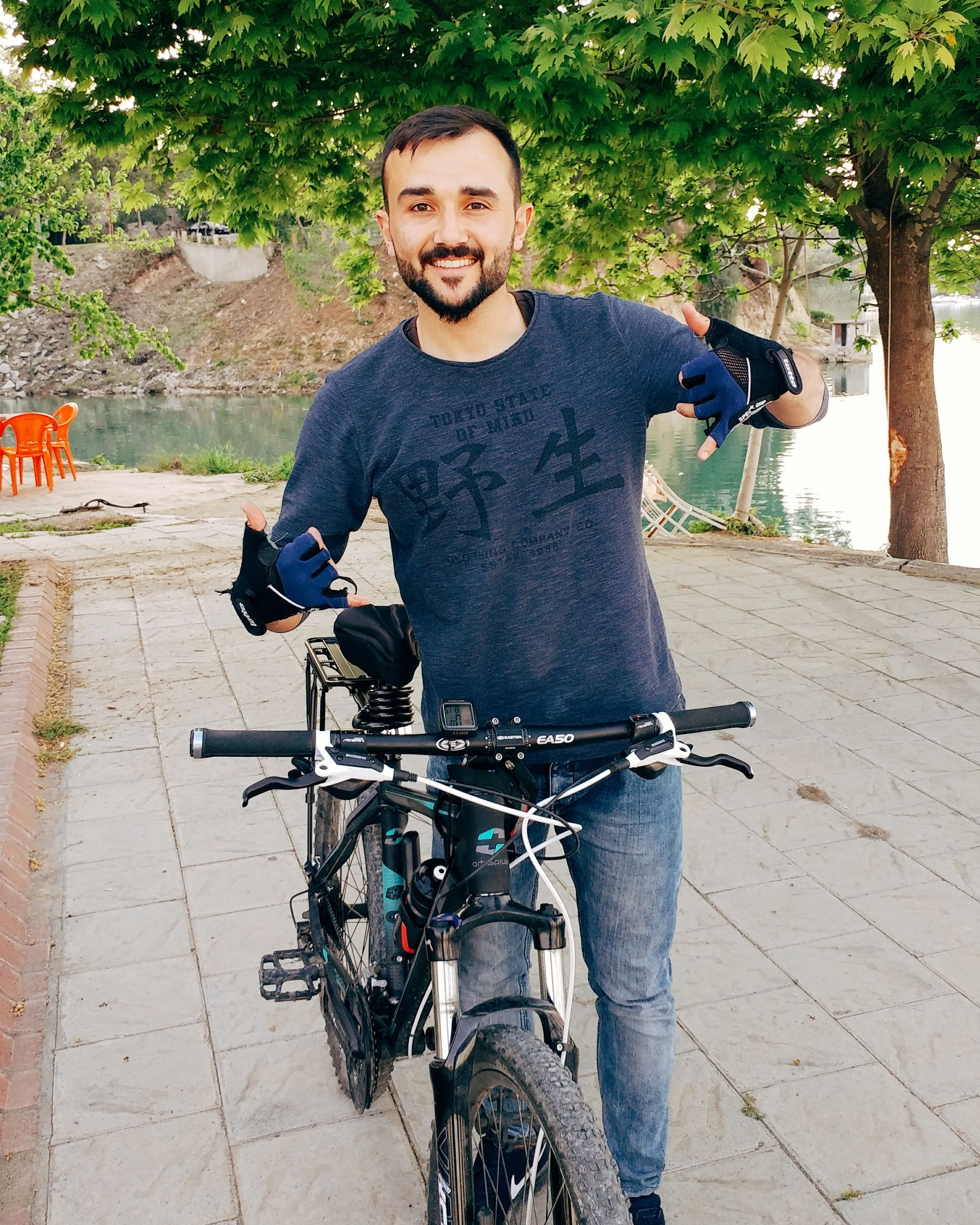 bicycle, young adult, only men, adults only, cycling, beard, transportation, adult, one man only, outdoors, portrait, casual clothing, one person, happiness, men, cheerful, lifestyles, people, leisure activity, city, smiling, real people, tree, day